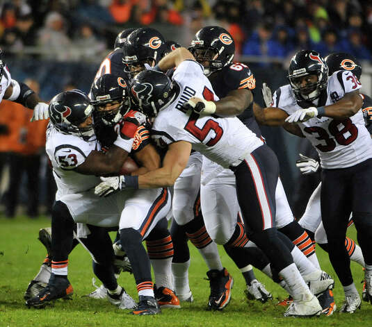 Matt Forte #22 of the Chicago Bears is tackled by Bradie James #53 of the Houston Texans and Barrett Ruud #54 on November 11, 2012 at Soldier Field in Chicago, Illinois. Photo: David Banks, Getty Images / 2012 Getty Images