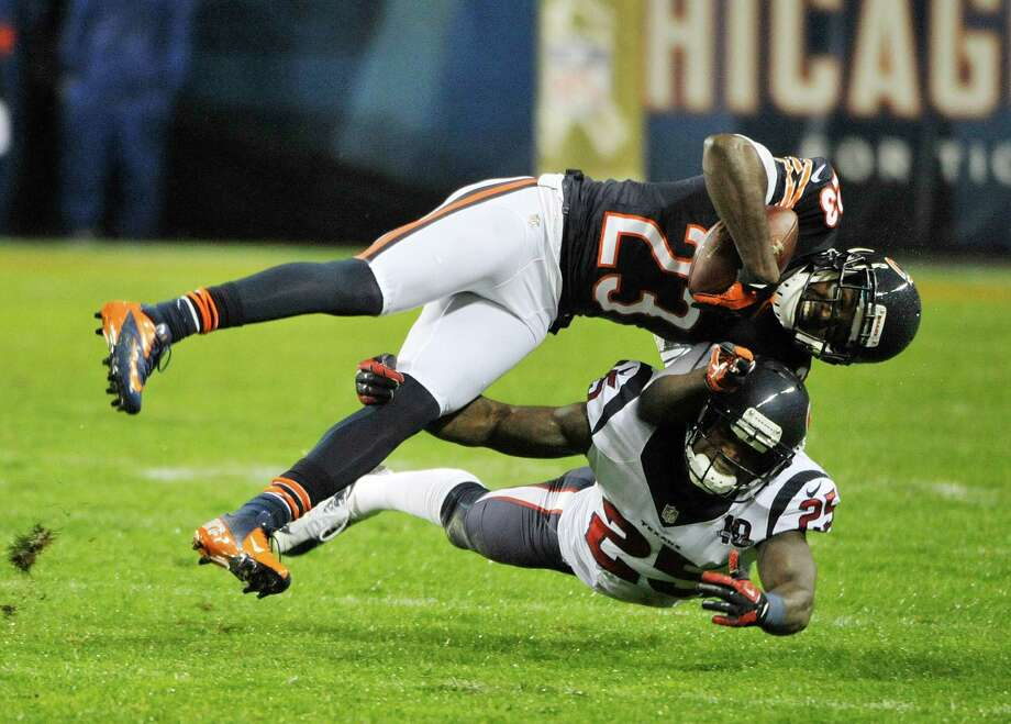 Devin Hester #23 of the Chicago Bears is tackled by Kareem Jackson #25 of the Houston Texans on November 11, 2012 at Soldier Field in Chicago, Illinois. Photo: David Banks, Getty Images / 2012 Getty Images