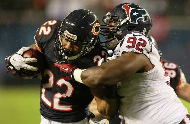 Running back Matt Forte #22 of the Chicago Bears carries the ball against defensive tackle Earl Mitchell #92 of the Houston Texans in the second quarter of the game at Soldier Field on November 11, 2012 in Chicago, Illinois. Photo: Jonathan Daniel, Getty Images / 2012 Getty Images