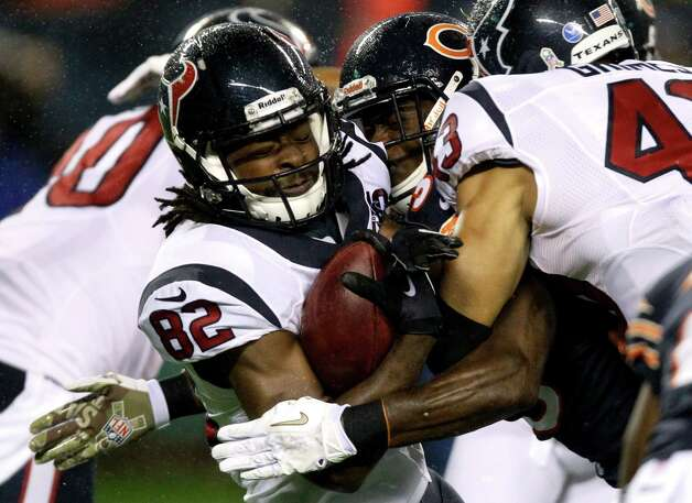Houston Texans wide receiver Keshawn Martin (82) tackled by Chicago Bears defensive back Zack Bowman during the first half an NFL football game, Sunday, Nov. 11, 2012,in Chicago. (AP Photo/Nam Y. Huh) Photo: Nam Y. Huh, Associated Press / AP