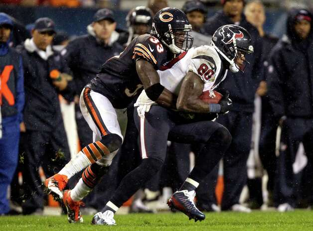 Houston Texans wide receiver Andre Johnson (80) is tackled after making a catch by Chicago Bears cornerback Charles Tillman (33) in the first half an NFL football game in Chicago, Sunday, Nov. 11, 2012. (AP Photo/Nam Y. Huh) Photo: Nam Y. Huh, Associated Press / AP