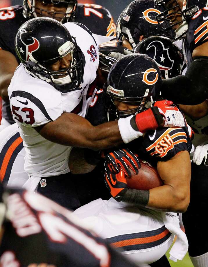 Chicago Bears running back Matt Forte, right, is tackled by Houston Texans linebacker Bradie James (53) during the first half an NFL football game, Sunday, Nov. 11, 2012, in Chicago. (AP Photo/Charles Rex Arbogast) Photo: Charles Rex Arbogast, Associated Press / AP