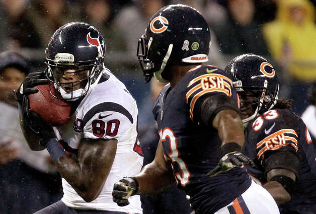 Houston Texans wide receiver Andre Johnson (80) makes a catch in front of Chicago Bears linebacker Nick Roach, center, and cornerback Charles Tillman (33) during the first half an NFL football game in Chicago, Sunday, Nov. 11, 2012. (AP Photo/Nam Y. Huh) Photo: Nam Y. Huh, Associated Press / AP