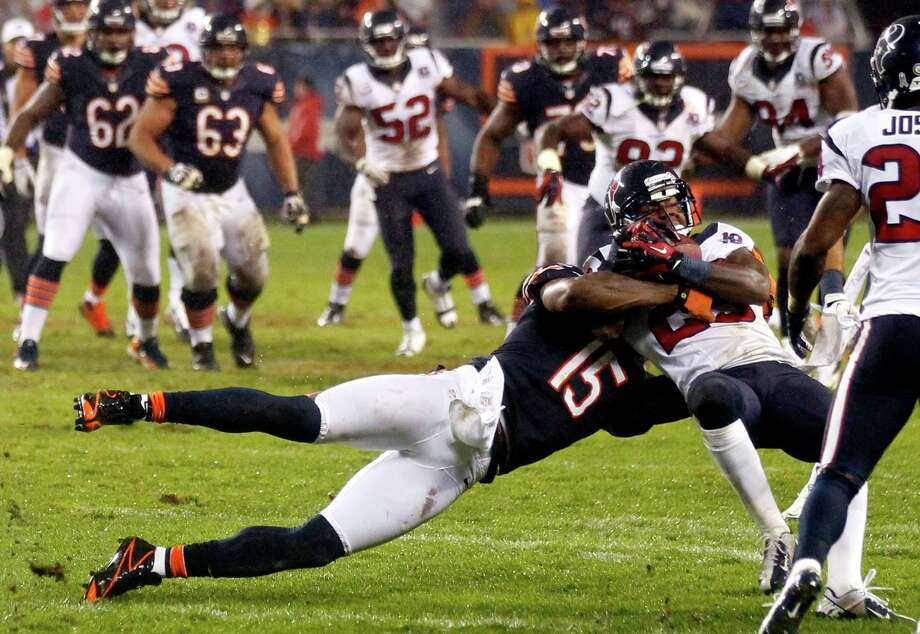Houston Texans cornerback Kareem Jackson intercepts a pass intended for Chicago Bears wide receiver Brandon Marshall (15) during the first half an NFL football game in Chicago, Sunday, Nov. 11, 2012. (AP Photo/Charles Rex Arbogast) Photo: Charles Rex Arbogast, Associated Press / AP