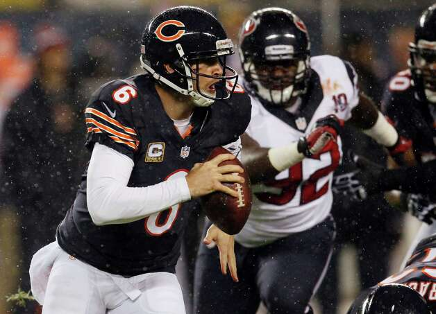 Chicago Bears quarterback Jay Cutler (6) scrambles away from Houston Texans defensive tackle Earl Mitchell (92) during the first half an NFL football game, Sunday, Nov. 11, 2012, in Chicago. (AP Photo/Charles Rex Arbogast) Photo: Charles Rex Arbogast, Associated Press / AP