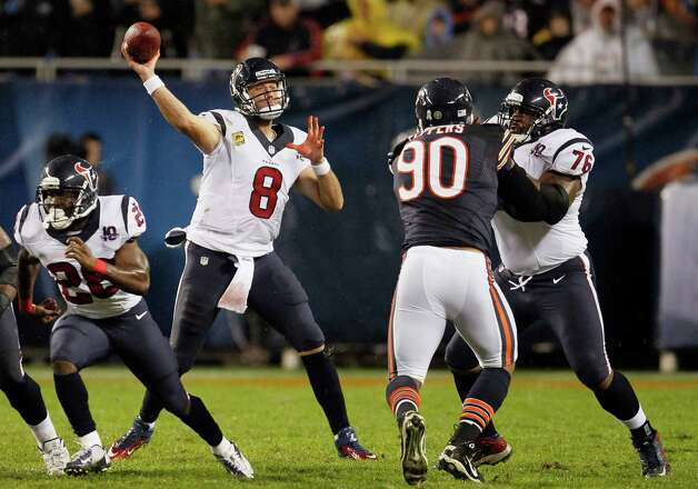 Houston Texans quarterback Matt Schaub (8) passes as tackle Duane Brown (76) blocks Chicago Bears defensive end Julius Peppers (90) during the first half an NFL football game, Sunday, Nov. 11, 2012, in Chicago. (AP Photo/Charles Rex Arbogast) Photo: Charles Rex Arbogast, Associated Press / AP