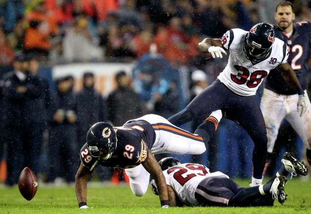 Chicago Bears running back Michael Bush (29) fumbles as he is tackled by Houston Texans safeties Glover Quin (29) and Danieal Manning (38) during the first half an NFL football game in Chicago, Sunday, Nov. 11, 2012. The ball was recovered by the Texans. (AP Photo/Nam Y. Huh) Photo: Nam Y. Huh, Associated Press / AP