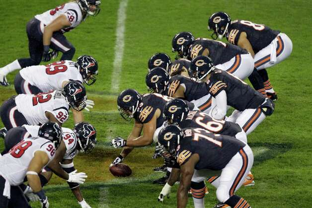 Chicago Bears quarterback Jay Cutler (6) prepares to take a snap in the first half an NFL football game against the Houston Texans in Chicago, Sunday, Nov. 11, 2012. (AP Photo/Kiichiro Sato) Photo: Kiichiro Sato, Associated Press / AP