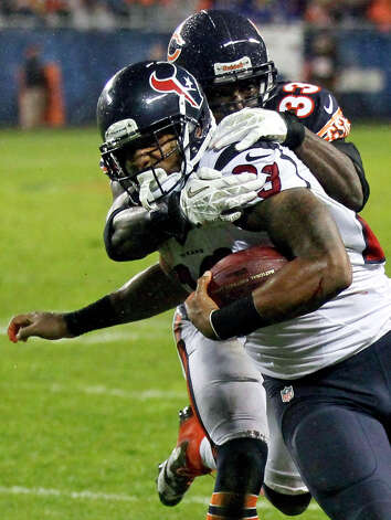 Houston Texans running back Arian Foster is tackled by Chicago Bears cornerback Charles Tillman (33) during the first half an NFL football game, Sunday, Nov. 11, 2012, in Chicago. (AP Photo/Charles Rex Arbogast) Photo: Charles Rex Arbogast, Associated Press / AP