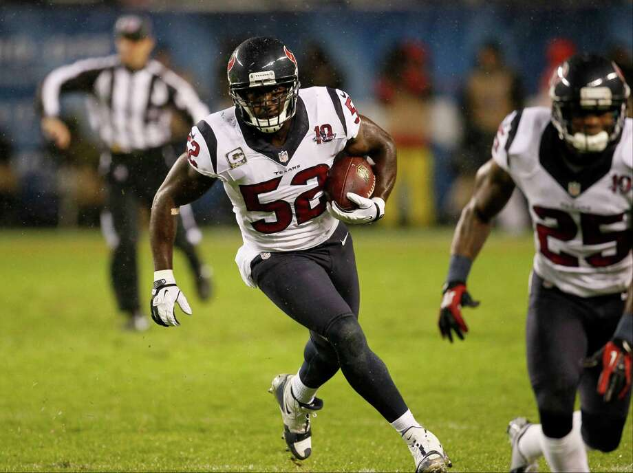 Houston Texans linebacker Tim Dobbins (52) runs after recovering a fumble by Chicago Bears tight end Kellen Davis (87) during the first half an NFL football game, Sunday, Nov. 11, 2012, in Chicago. (AP Photo/Charles Rex Arbogast) Photo: Charles Rex Arbogast, Associated Press / AP