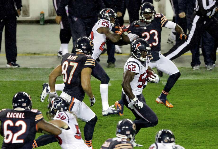 Houston Texans linebacker Tim Dobbins (52) runs after recovering a fumble by Chicago Bears tight end Kellen Davis (87) during the first half of an NFL football game, Sunday, Nov. 11, 2012, in Chicago. Davis made the tackle on Dobbins. (AP Photo/Kiichiro Sato) Photo: Kiichiro Sato, Associated Press / AP