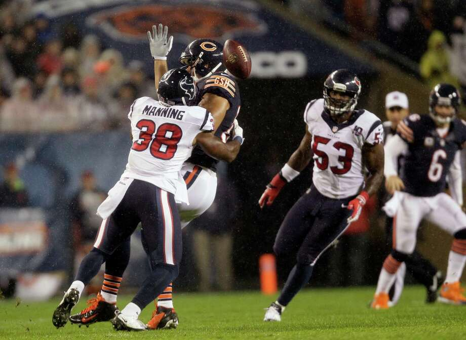 Chicago Bears tight end Kellen Davis fumbles as he is tackled by Houston Texans safety Danieal Manning (38)  in the first half an NFL football game in Chicago, Sunday, Nov. 11, 2012. (AP Photo/Nam Y. Huh) Photo: Nam Y. Huh, Associated Press / AP
