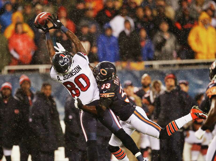 Chicago Bears cornerback Charles Tillman (33) breaks up a pass intended for Houston Texans wide receiver Andre Johnson (80)in the first half an NFL football game in Chicago, Sunday, Nov. 11, 2012. (AP Photo/Charles Rex Arbogast) Photo: Charles Rex Arbogast, Associated Press / AP