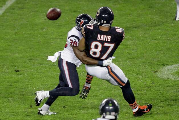 Chicago Bears tight end Kellen Davis (87) fumbles as he is tackled by Houston Texans safety Danieal Manning (38) during the first half of an NFL football game, Sunday, Nov. 11, 2012, in Chicago. The Texans recovered the ball. (AP Photo/Kiichiro Sato) Photo: Kiichiro Sato, Associated Press / AP
