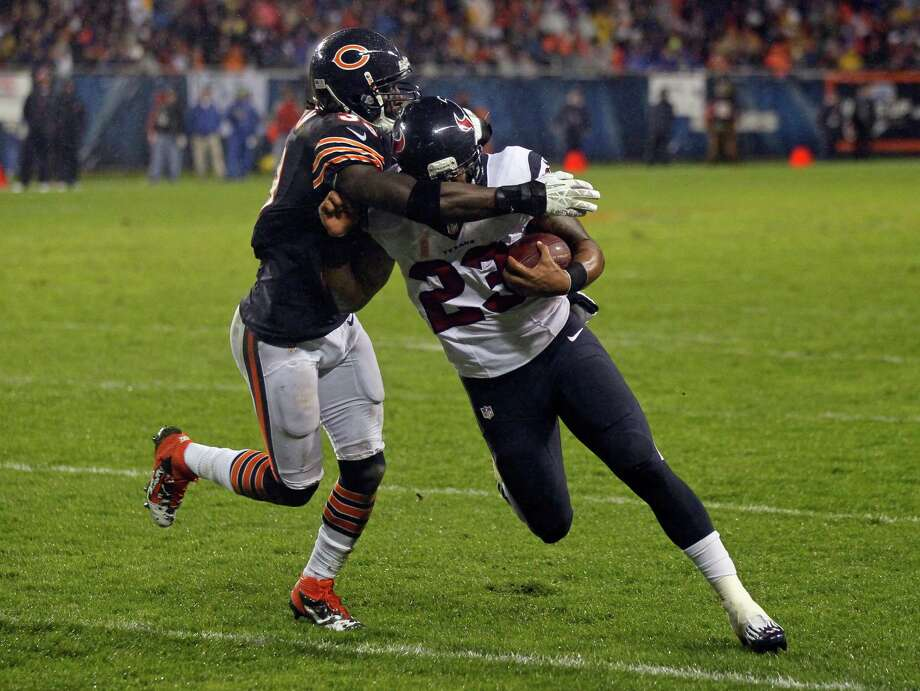 Chicago Bears cornerback Charles Tillman (33) tackles Arian Foster in the first half an NFL football game in Chicago, Sunday, Nov. 11, 2012. (AP Photo/Charles Rex Arbogast) Photo: Charles Rex Arbogast, Associated Press / AP