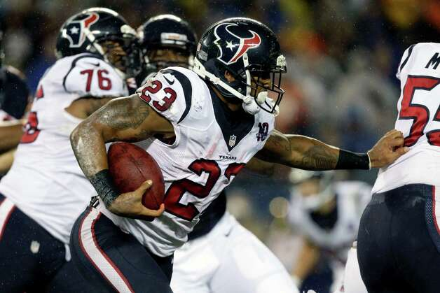 Houston Texans running back Arian Foster (23) looks for running room behind against the Chicago Bears during the first half an NFL football game Sunday, Nov. 11, 2012, in Chicago. (AP Photo/Nam Y. Huh) Photo: Nam Y. Huh, Associated Press / AP