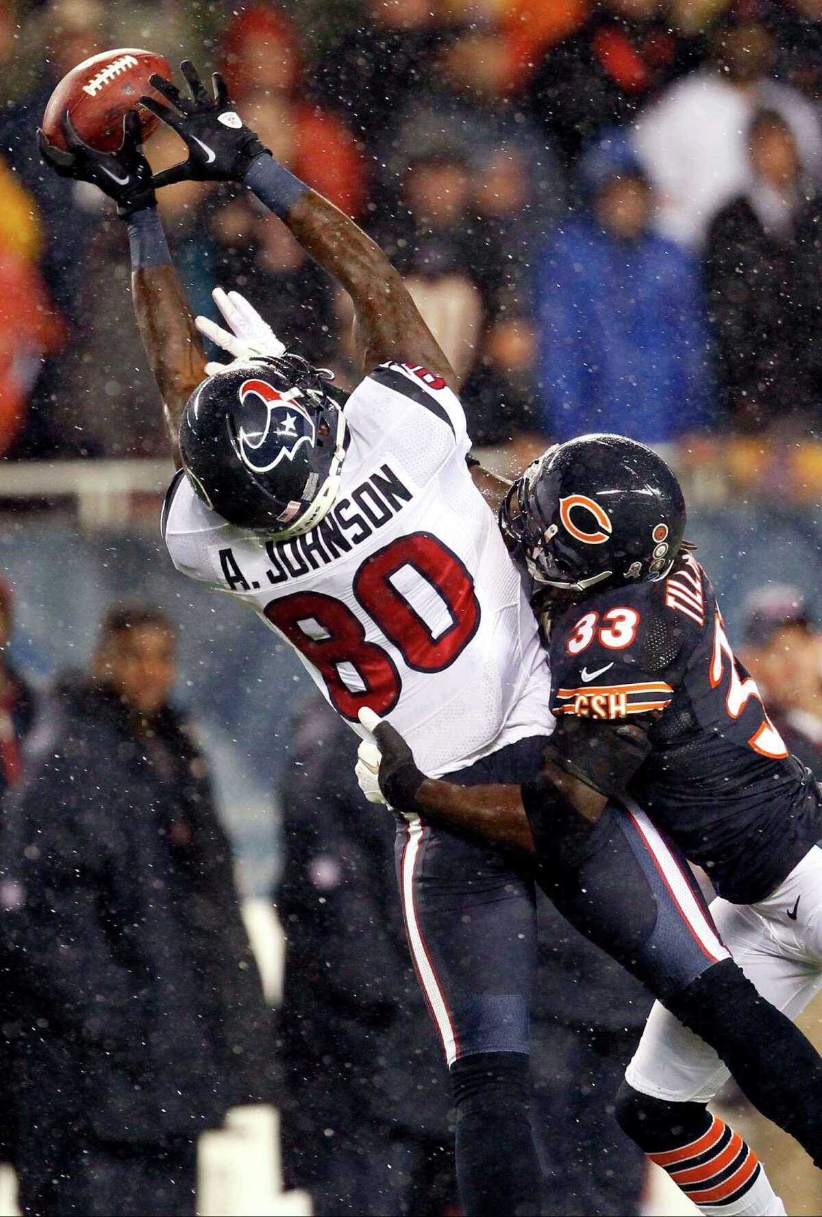 Chicago Bears cornerback Charles Tillman (33) breaks up a pass intended for Houston Texans wide receiver Andre Johnson (80) in the first half an NFL football game, Sunday, Nov. 11, 2012, in Chicago. (AP Photo/Charles Rex Arbogast)