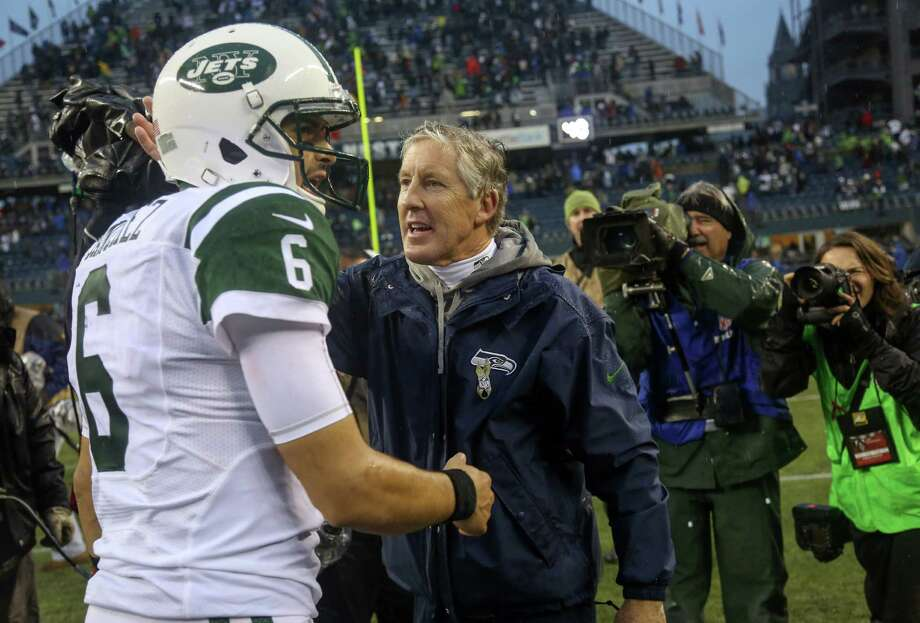 SEATTLE, WA - NOVEMBER 11:  Head coach Pete Carroll of the Seattle Seahawks is congratulated by quarterback Mark Sanchez #6 of the New York Jets after the Seahawks defeated the Jets 28-7 at CenturyLink Field on November 11, 2012 in Seattle, Washington.  (Photo by Otto Greule Jr/Getty Images) Photo: Otto Greule Jr
