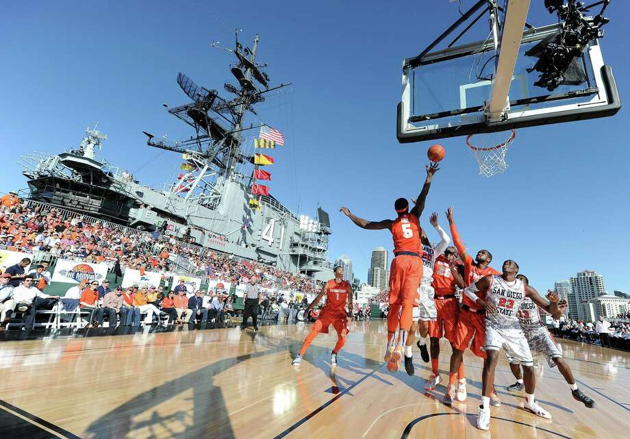 After attempts to play on aircraft carriers on Friday night in Jacksonville, Fla., and Charleston, S.C., ended with the games shortened or canceled due to slippery court conditions, Sunday's game between Syracuse and San Diego State on the USS Midway in San Diego went off without a hitch. The Orange won 62-49. Photo: Harry How, Staff / 2012 Getty Images