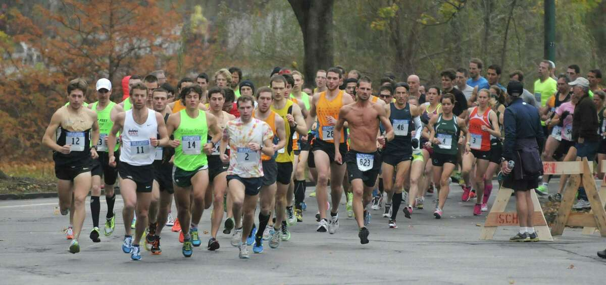 Runners make their way through the course around Central Park at the start of the Stockadeathon on Sunday, Nov. 11, 2012 in Schenectady, NY. (Paul Buckowski / Times Union)