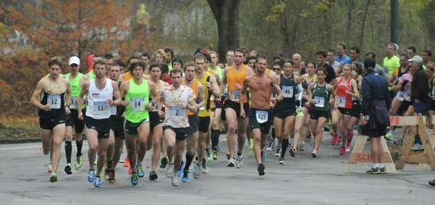 Runners make their way through the course around  Central Park at the start of the Stockadeathon on Sunday, Nov. 11, 2012 in Schenectady, NY.  (Paul Buckowski / Times Union) Photo: Paul Buckowski