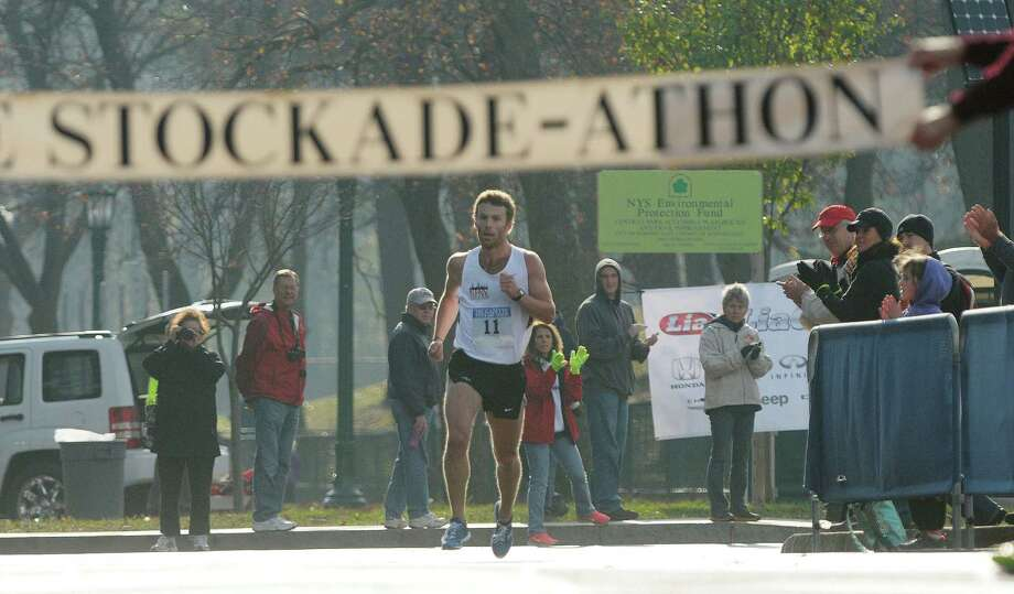 Christian Thompson from Elkins Park, PA is all alone as he leads all runners heading to the finish line in Central Park during the Stockadeathon on Sunday, Nov. 11, 2012 in Schenectady, NY.  (Paul Buckowski / Times Union) Photo: Paul Buckowski