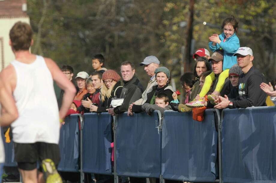 Spectators cheer as runners make their way towards the finish line  in  Central Park during the Stockadeathon on Sunday, Nov. 11, 2012 in Schenectady, NY.  (Paul Buckowski / Times Union) Photo: Paul Buckowski