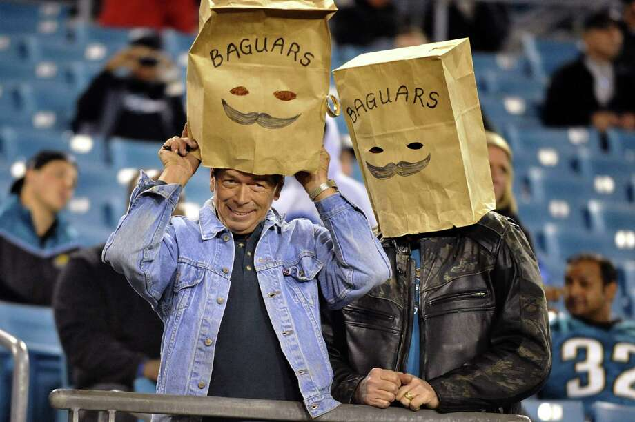 """They're not quite the """"Ain'ts,"""" but Jaguars fans have taken to wearing their own message-driven bags at home games for the team, which is 1-8 after Thursday night's setback to the Colts and hasn't been competitive in many of its losses. Photo: Stephen Morton, FRE / FR56856 AP"""