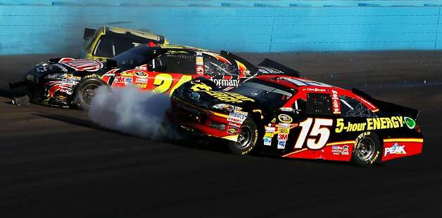 Jeff Gordon (center), nursing a grudge for previous too-close encounters with Clint Bowyer (No. 15), intentionally wrecked him. Photo: Tom Pennington, Getty Images For NASCAR