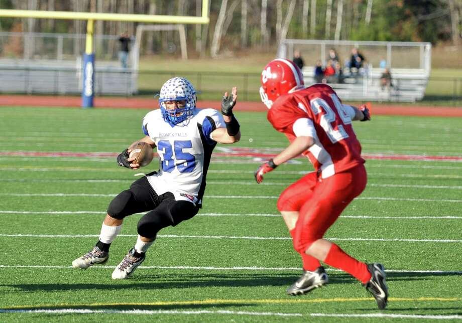 Brad Burns runs for yardage against Saranac Lake at AuSable Valley High School on Saturday, Nov. 10, 2012. (Steve Bradley / Times Union)