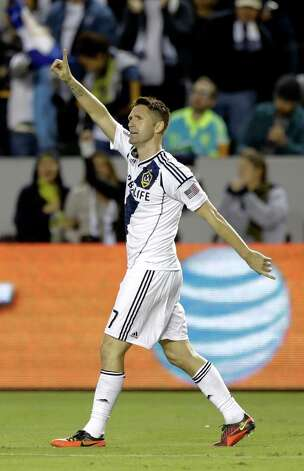 Los Angeles Galaxy's Robbie Keane celebrates his goal against the Seattle Sounders during the first half of an MLS Western Conference finals soccer game in Carson, Calif., Sunday, Nov. 11, 2012. Photo: AP