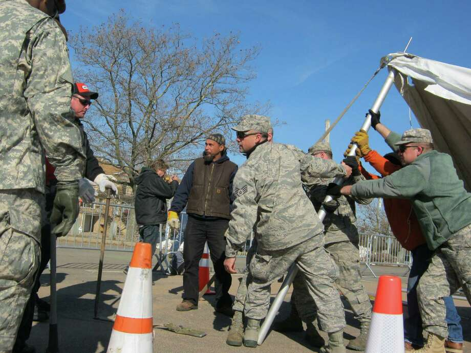 Members of 109th Airlift Wing help put up a distribution tent in Staten Island. (Alysia Santo / Times Union)