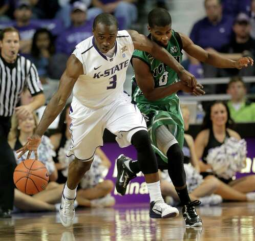 Kansas State guard Martavious Irving (3) wards off North Dakota guard Aaron Anderson (0) while driving during the first half of an NCAA college basketball game on Friday, Nov. 9, 2012, in Manhattan, Kan. (AP Photo/Charlie Riedel) Photo: Charlie Riedel, STF