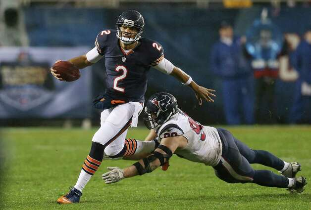 Quarterback Jason Campbell #2 of the Chicago Bears avoids the tackle of defensive end J.J. Watt #99 of the Houston Texans in the third quarter of the game at Soldier Field on November 11, 2012 in Chicago, Illinois. Photo: Jonathan Daniel, Getty Images / 2012 Getty Images
