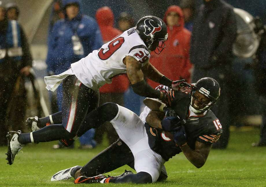 Wide receiver Brandon Marshall #15 of the Chicago Bears is tackled by strong safety Glover Quin #29 and cornerback Johnathan Joseph #24 of the Houston Texans in the third quarter of the game at Soldier Field on November 11, 2012 in Chicago, Illinois. Photo: Jonathan Daniel, Getty Images / 2012 Getty Images