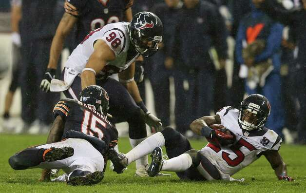 Cornerback Kareem Jackson #25 of the Houston Texans intercepts a pass intended for wide receiver Brandon Marshall #15 of the Chicago Bears during the game at Soldier Field on November 11, 2012 in Chicago, Illinois. Photo: Jonathan Daniel, Getty Images / 2012 Getty Images