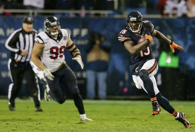 Wide receiver Brandon Marshall #15 of the Chicago Bears carries the ball against the defense of defensive end J.J. Watt #99 of the Houston Texans during the game at Soldier Field on November 11, 2012 in Chicago, Illinois. Photo: Jonathan Daniel, Getty Images / 2012 Getty Images
