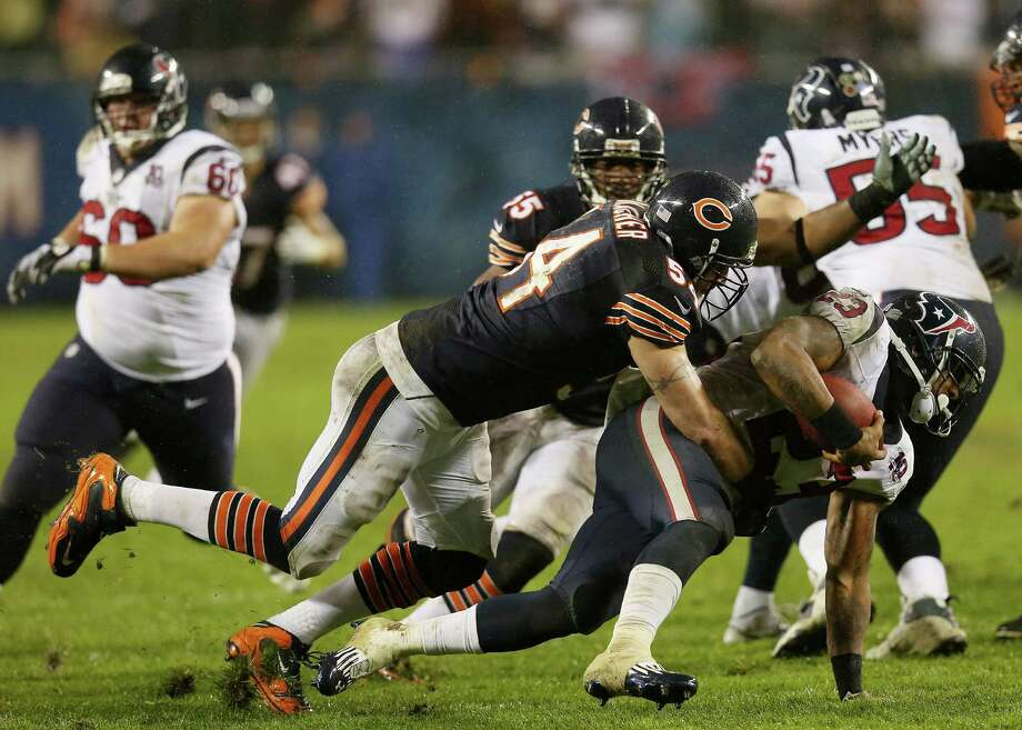 Running back Arian Foster #23 of the Houston Texans is tackled by middle linebacker Brian Urlacher #54 of the Chicago Bears in the second quarter during the game at Soldier Field on November 11, 2012 in Chicago, Illinois. Photo: Jonathan Daniel, Getty Images / 2012 Getty Images