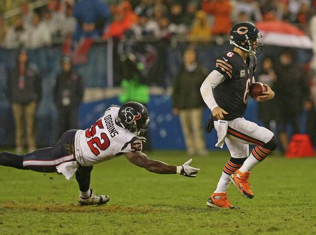 Jay Cutler #6 of the Chicago Bears breaks away from Tim Dobbins #52 of the Houston Texans at Soldier Field on November 11, 2012 in Chicago, Illinois. The Texans defeated the Bears 13-6. Photo: Jonathan Daniel, Getty Images / 2012 Getty Images