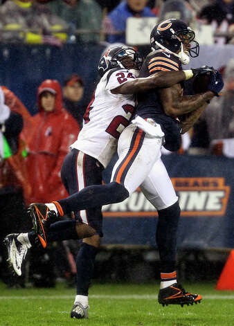 Chicago Bears wide receiver Brandon Marshall (15) makes a catch against Houston Texans cornerback Johnathan Joseph (24) during the second half of an NFL football game, Sunday, Nov. 11, 2012, in Chicago. (AP Photo/Nam Y. Huh) Photo: Nam Y. Huh, Associated Press / AP