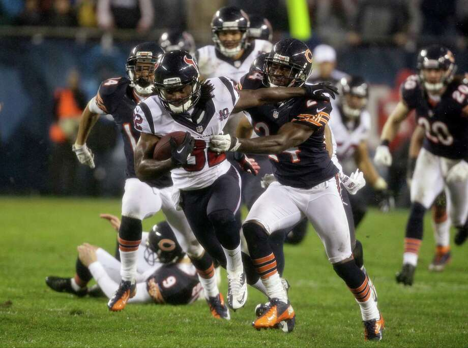 Houston Texans' Keshawn Martin (82)pushes off Chicago Bears' Kelvin Hayden (24) during a kickoff return in the second half an NFL football game in Chicago, Sunday, Nov. 11, 2012. (AP Photo/Nam Y. Huh) Photo: Nam Y. Huh, Associated Press / AP
