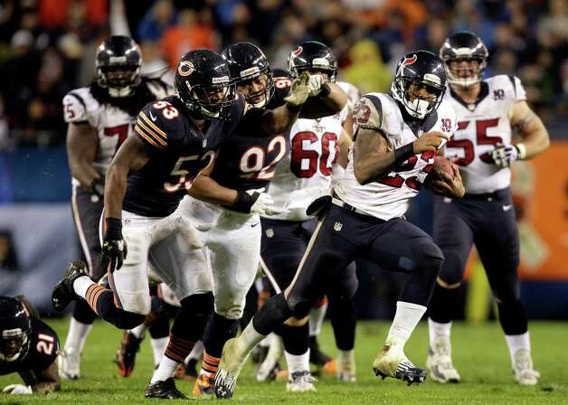 Houston Texans running back Arian Foster (23) rushes past Chicago Bears linebacker Nick Roach (53) and defensive tackle Stephen Paea (92) during the first half an NFL football game, Sunday, Nov. 11, 2012, in Chicago. (AP Photo/Nam Y. Huh) Photo: Nam Y. Huh, Associated Press / AP