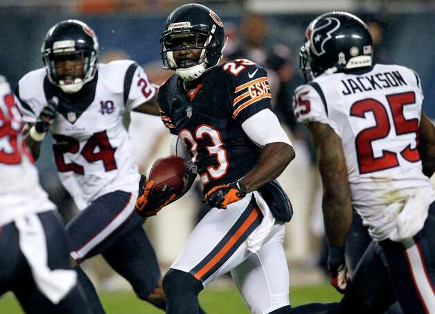 Chicago Bears wide receiver Devin Hester (23) runs between Houston Texans defenders Kareem Jackson (25) and Johnathan Joseph (24) during the first half an NFL football game, Sunday, Nov. 11, 2012, in Chicago. (AP Photo/Charles Rex Arbogast) Photo: Charles Rex Arbogast, Associated Press / AP