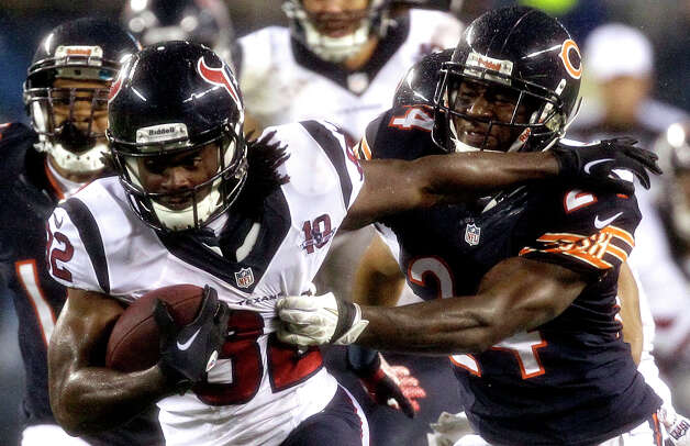 Houston Texans' Keshawn Martin (82) pushes off Chicago Bears' Kelvin Hayden (24) during a kickoff return during the second half an NFL football game, Sunday, Nov. 11, 2012, in Chicago. (AP Photo/Nam Y. Huh) Photo: Nam Y. Huh, Associated Press / AP