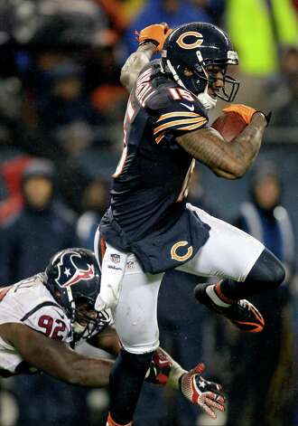Chicago Bears wide receiver Brandon Marshall (15) breaks away from Houston Texans defensive tackle Earl Mitchell (92) during the first half an NFL football game, Sunday, Nov. 11, 2012, in Chicago. (AP Photo/Nam Y. Huh) Photo: Nam Y. Huh, Associated Press / AP