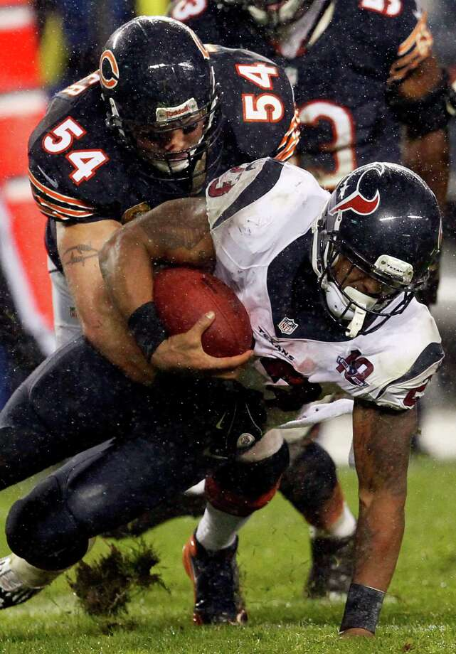 Chicago Bears linebacker Brian Urlacher (54) tackles Houston Texans running back Arian Foster (23) during the first half an NFL football game, Sunday, Nov. 11, 2012, in Chicago. (AP Photo/Charles Rex Arbogast) Photo: Charles Rex Arbogast, Associated Press / AP