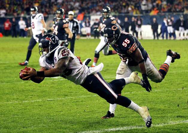 Houston Texans running back Arian Foster (23) makes a touchdown catch with Chicago Bears linebacker Lance Briggs (55) defending in the first half an NFL football game in Chicago, Sunday, Nov. 11, 2012. (AP Photo/Charles Rex Arbogast) Photo: Charles Rex Arbogast, Associated Press / AP