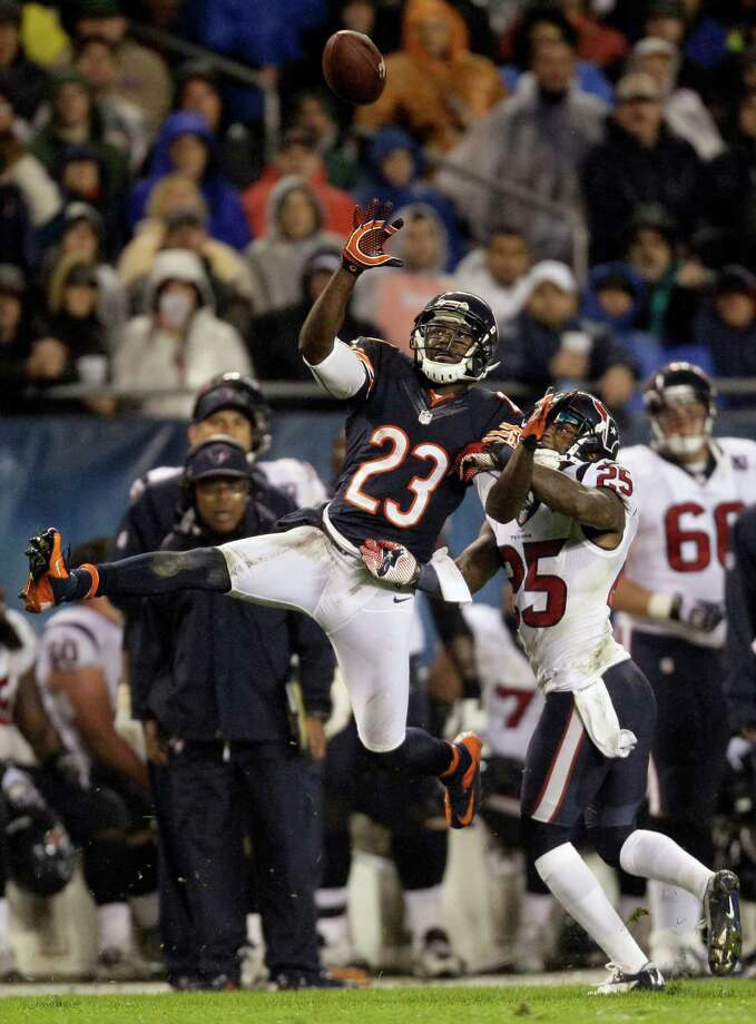 Chicago Bears wide receiver Devin Hester (23) misses a catch while defended by Houston Texans cornerback Kareem Jackson (25) during the first half an NFL football game in Chicago, Sunday, Nov. 11, 2012. (AP Photo/Nam Y. Huh) Photo: Nam Y. Huh, Associated Press / AP