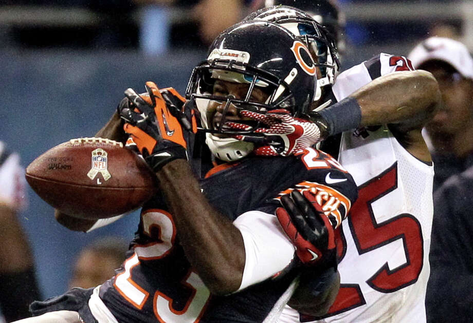 Chicago Bears wide receiver Devin Hester (23) misses a catch while under pressure from Houston Texans cornerback Kareem Jackson (25) in the first half an NFL football game, Sunday, Nov. 11, 2012, in Chicago. (AP Photo/Nam Y. Huh) Photo: Nam Y. Huh, Associated Press / AP