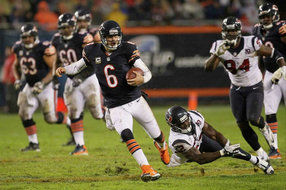 Chicago Bears quarterback Jay Cutler (6) eludes a tackle by Houston Texans linebacker Tim Dobbins (52) in the first half an NFL football game in Chicago, Sunday, Nov. 11, 2012. (AP Photo/Charles Rex Arbogast) Photo: Charles Rex Arbogast, Associated Press / AP